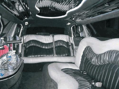 Chauffeur driven stretched limousine white Chrysler C300 Baby Bentley with jet doors interior available in Brighton, Eastbourne, Hastings, Portsmouth, Crawley, Tunbridge Wells, Lewes, Worthing, Chichester, Bognor Regis, Horsham, East Grinstead, East Sussex and West Sussex.