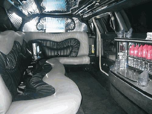 Chauffeur driven stretched limo white Chrysler C300 Baby Bentley with jet doors interior available in Brighton, Eastbourne, Hastings, Portsmouth, Crawley, Tunbridge Wells, Lewes, Worthing, Chichester, Bognor Regis, Horsham, East Grinstead, East Sussex and West Sussex.