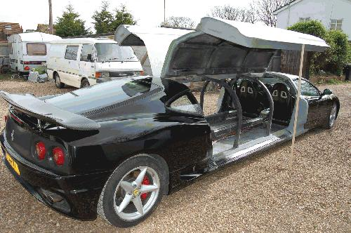 Chauffer driven stretched black Ferrari F1 360 limousine hire in the UK with jet doors.
