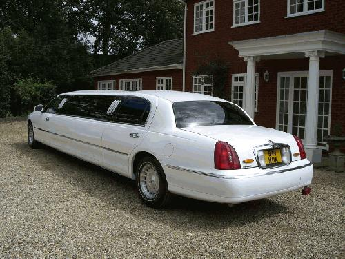 Chauffeur stretch white Lincoln Millenium Town Car limo 8 seater with TV, DVD and Mirror bar in East of England, Peterborough, Huntingdon, Stanford, King's Lynn, Norwich, Great Yarmouth, Lowestoft, Wisbech, Spalding, Cambridge, Cambridgeshire, Bedford, Bedfordshire, Newmarket, Bury St Edmunds, Suffolk, Norfolk, Lincolnshire, Northampton, Northamptonshire, Kettering, Leicester and Sudbury.