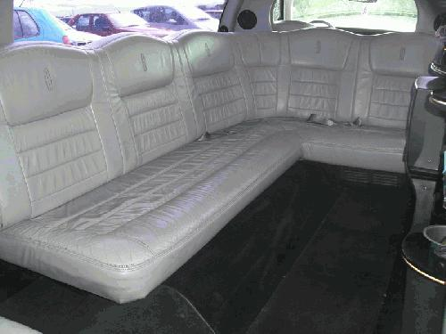 Chauffeur driven stretched white Lincoln Millenium Town Car limousine 8 seater with TV, DVD and Mirror bar interior in East of England, Peterborough, Huntingdon, Stanford, King's Lynn, Norwich, Great Yarmouth, Lowestoft, Wisbech, Spalding, Cambridge, Cambridgeshire, Bedford, Bedfordshire, Newmarket, Bury St Edmunds, Suffolk, Norfolk, Lincolnshire, Northampton, Northamptonshire, Kettering, Leiceste