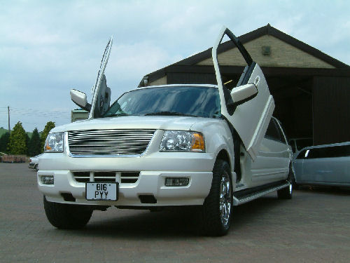 Chauffeur stretch white Ford Excursion 4x4 limousine hire with Lamborghini doors in Sheffield, Rotherham, Barnsley, Doncaster, Huddersfield, South Yorkshire.
