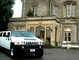 Chauffeur stretched silver Hummer limousine hire in Birmingham, Coventry, Dudley, Wolverhampton, Telford, Worcester, Walsall, Stafford