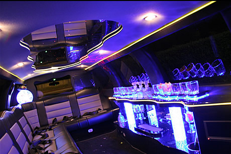 Chauffeur stretched white Lincoln Navigator limousine hire interior in Birmingham, Coventry, Dudley, Wolverhampton, Telford, Worcester, Walsall, Stafford