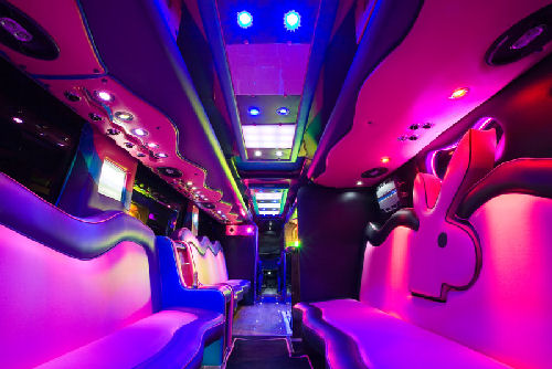 Chauffeur driven Party Bus limo hire Playboy den interior in Bristol, Gloucester, Cheltenham, Cardiff, Wales, Weston Super Mare, and Bath.