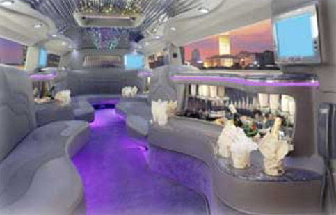 Chauffeur stretched pink Hummer H2 limo hire interior in UK